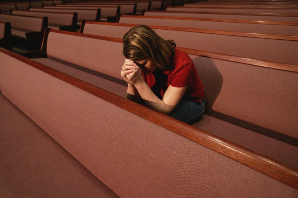 woman-church-praying-e1404830992353