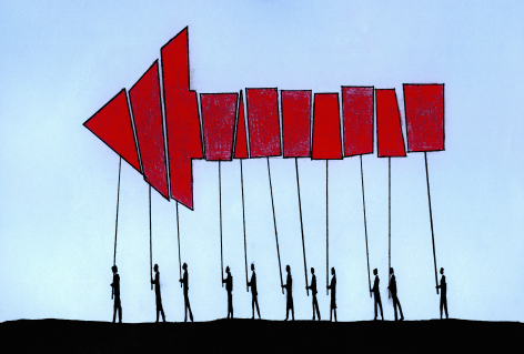 Red arrow formed from pieces by people cooperating and working together